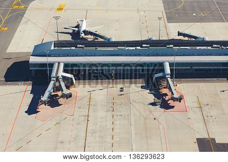 Aerial view of a modern international airport terminal. Traveling around the world.