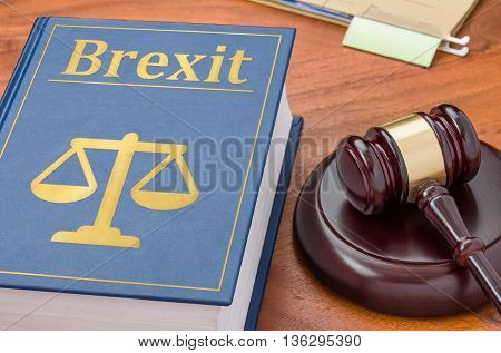 A Law Book With A Gavel - Brexit