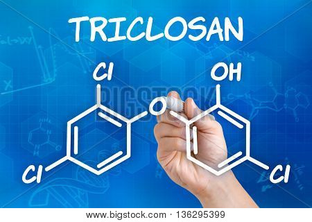 Hand With Pen Drawing The Chemical Formula Of Triclosan