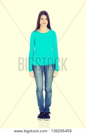 Young casual woman standing.