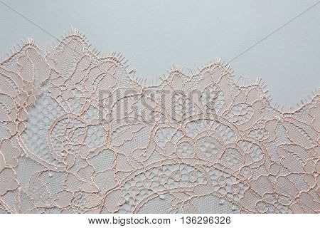 peach lace lying on a white background