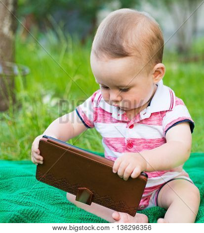 Baby boy with tablet computer. Little boy with touch pad early learning