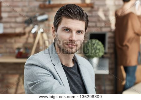 Portrait of handsome young businessman, looking at camera.