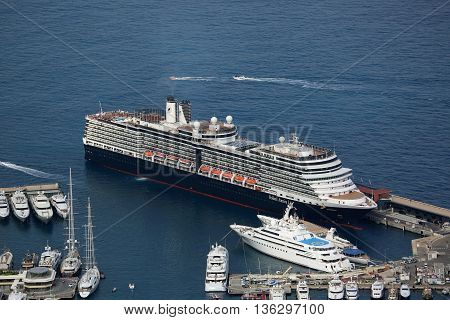 Monte-Carlo Monaco - June 1 2016: Aerial View of MS Eurodam Signature Cruise Ship (Holland America Line) and others Luxury Yachts in Port Hercule in Monaco
