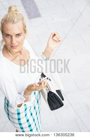 Portrait of young beautiful woman using a smartphone