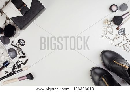 Women's accessories and cosmetics. Top view photo of colorful and glamour objects with free space for logo. There are shoes and perse