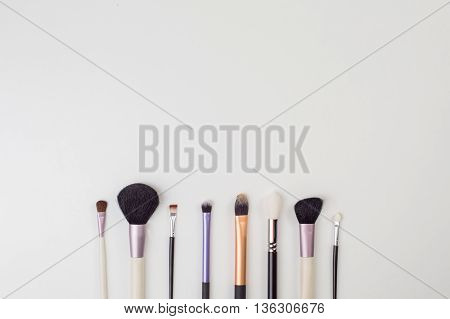 Women's makeup brushes. Top view photo of glamour professional makeup brushes with free space for logo