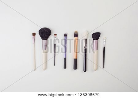 Women's makeup brushes. Top view photo of glamour professional makeup brushes