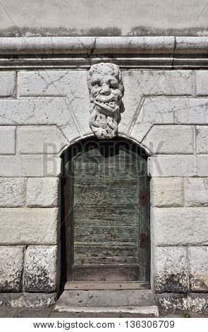 Bizzarre monster guardian head on Santa Formosa bell tower in Venice (17th century)