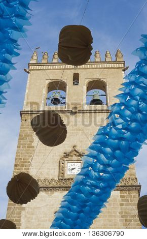 Badajoz Cathedral tower between paper lanterns during San Juan Festivities Fair