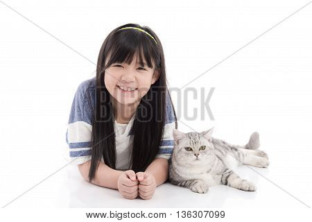 Beautiful Asian girl playing with lovely tabby kitten on white background isolated