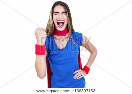 Woman in superhero costume shouting on white background