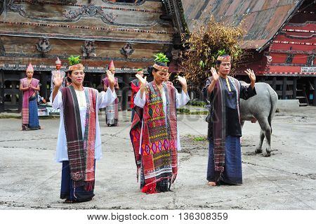 SUMATRA, INDONESIA - 22 MAY 2015 : Traditional Batak dancers performing a ceremonial dance in Bolon Simanindo Batak Museum Village. Batak stands for the ethnic people living in the northern part of Sumatra Island of Indonesia.