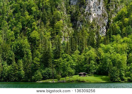 Remote chalet on banks of Konigssee in spring sunshine.