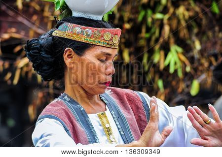 SUMATRA, INDONESIA - 22 MAY 2015 : A Traditional Batak Dancer performing a ceremonial dance in Bolon Simanindo Batak Museum Village in 22 May 2015