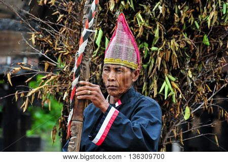 SUMATRA, INDONESIA - 22 MAY 2015 : A Traditional Batak Wizard performing in a ceremonial dance in Bolon Simanindo Batak Museum Village. Batak stands for the ethnic people living in the northern part of Sumatra Island of Indonesia.