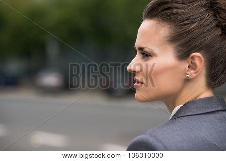 Profile Portrait Of Pensive Business Woman At Office District