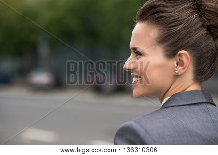 Profile Portrait Of Smiling Business Woman At Office District