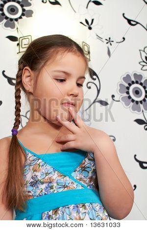 A Little Girl In Blue Dress
