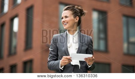 Modern Business Woman With Tablet Pc Looking Aside