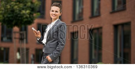 Happy Modern Business Woman With Cellphone At Office District