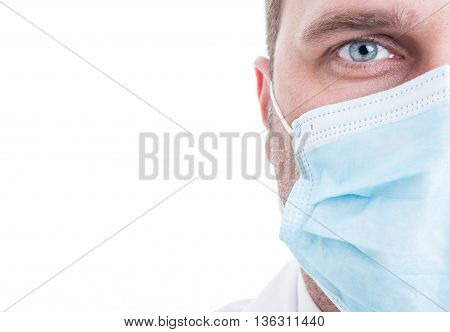 Close-up Of Half Medic Face With Surgical Mask