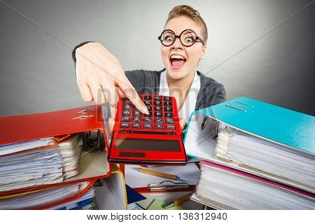 Bureau calculation book keeping company concept. Workaholic secretary making gestures. Nervous office lady holding pointing at calculator.