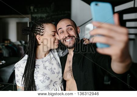 handsome man and beautiful woman making selfie indoors