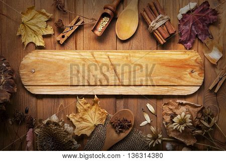autumn background with  spices, dried flowers, copy place for inscription, top view