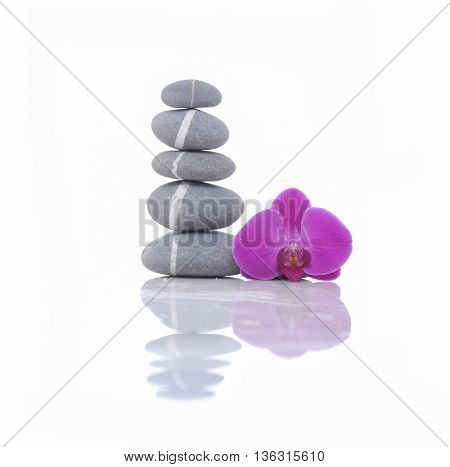 striped stacked stones and pink orchid