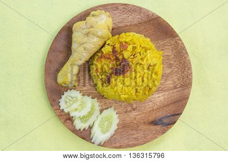 Muslim yellow rice with chicken / chicken biryani or Curry Rice with Chicken