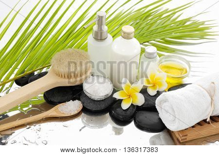 Spa set with green palm background