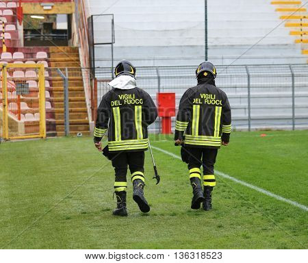 Two Italian Firefighters With Uniform With The Written Firefighters