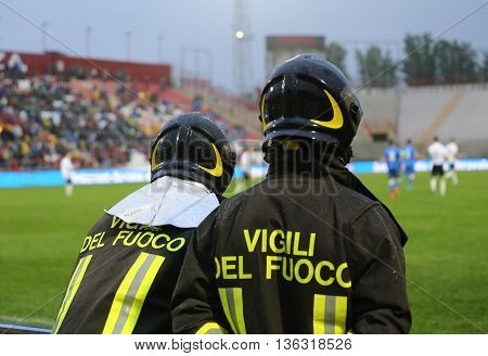 Two Italian Firefighters With Uniform With The Inscription Firefighters In The Stadium