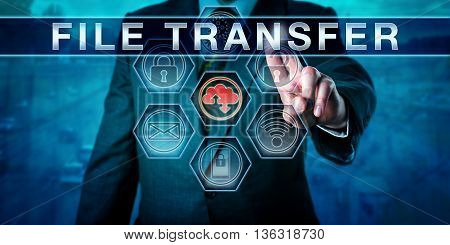 Corporate client is touching FILE TRANSFER on an interactive virtual control monitor. internet terminology business metaphor and information technology concept for secure network data transfer.