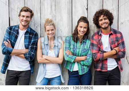 Group of friends leaning with arms crossed