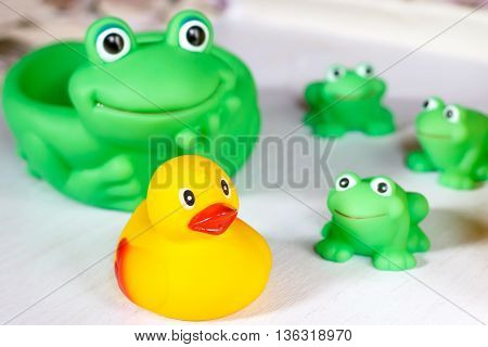 Child bath toys on a white wooden surface
