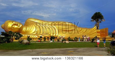 Laem Phor Reclining Buddha, close to 99 feet long, on Ko Yo Island near Songkhla, Thailand