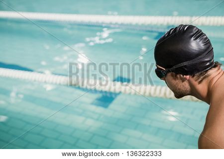Swimmer about to dive into the pool at leisure center