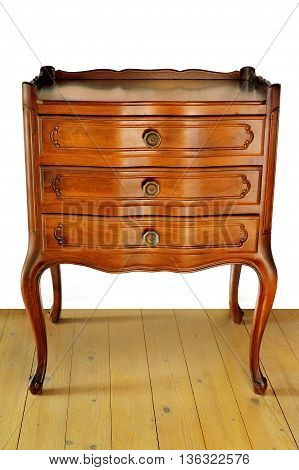 The old bedside stand on a wooden floor with white background