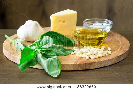 Sicilian basil pesto ingredients on wooden table
