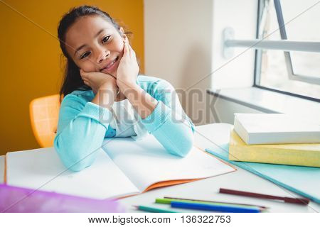 Girl sitting at a desk at school