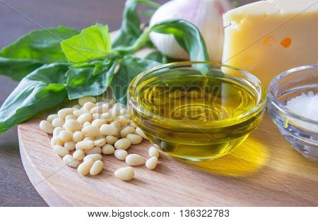 Sicilian basil pesto ingredients on wooden table. macro