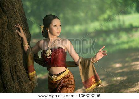 Thai woman in tradition silk dress.Asia beautiful custom.