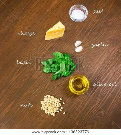 Sicilian basil pesto ingredients on wooden table. with caption