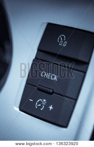 Close up shot of the check button in a car.