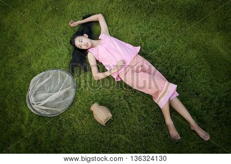 Girl lying on prairie with a sense of freedom of life.