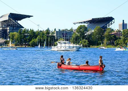 Seattle, Wa - March 23, 2011: Children On The Boat, Husky Stadium At The Background
