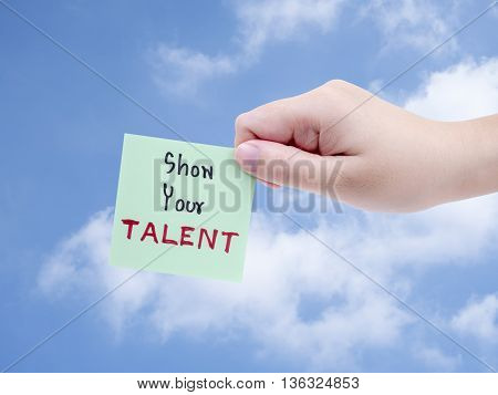 Single smart business woman hold handwriting Show Your Talent on notepad in right hand on blue sky background with clipping path