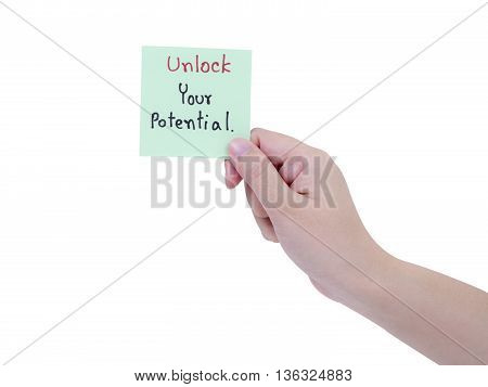 Single smart business woman hold handwriting Unlock Your Potential on notepad in right hand on isolated / white background with clipping path